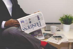 Effective morning habits man reading newspaper